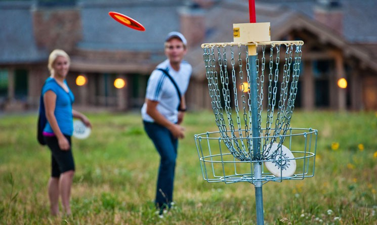 two people playing disc golf